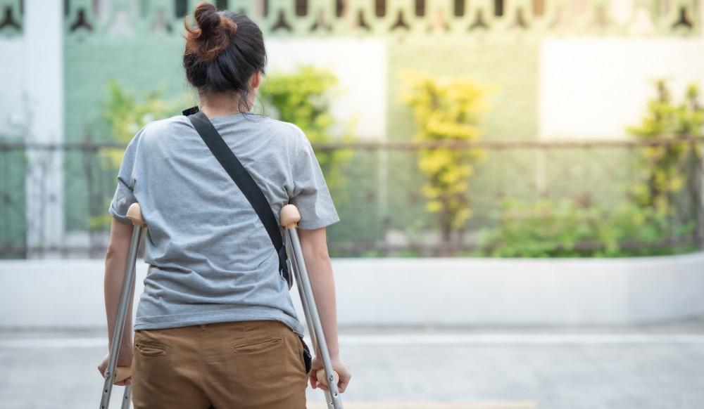 Woman using crutches